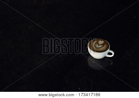 Coffee Cup With Latte Art On The Floor After Raining At Night