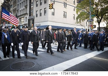 NEW YORK - 11 NOV 2016: James O'Neill, NYPD Police Commissioner and members of the New York City Police Department NYPD, march in the annual Americas Parade up 5th Avenue on Veterans Day in Manhattan.