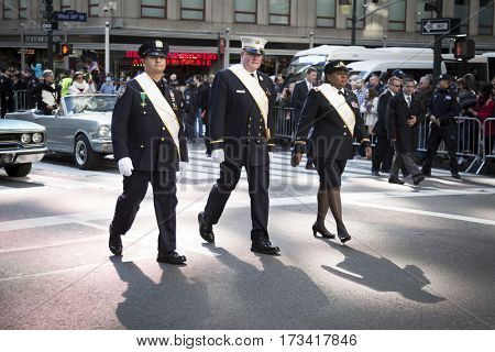 NEW YORK - 11 NOV 2016: 2016 Grand Marshals Stephanie Dawson, Joseph Duggan Jr., and Nelson Vergara march in the annual Americas Parade up 5th Avenue on Veterans Day in Manhattan.
