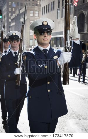 NEW YORK - 11 NOV 2016: US Coast Guard personnel, USCG march in Americas Parade up 5th Avenue on Veterans Day in Manhattan.