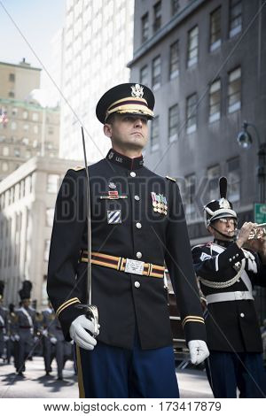 NEW YORK - 11 NOV 2016: US Army personnel in uniform march in Americas Parade up 5th Avenue on Veterans Day in Manhattan.