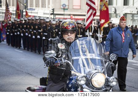 NEW YORK - 11 NOV 2016: Biker and US Marine Corps personnel, USMC march in Americas Parade up 5th Avenue on Veterans Day in Manhattan.