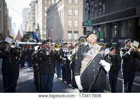 NEW YORK - 11 NOV 2016: Marching band - US Army personnel march in Americas Parade up 5th Avenue on Veterans Day in Manhattan.