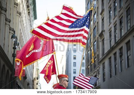 NEW YORK - 11 NOV 2016: American Flag and flag of US Marine Corps, USMC carried by personel marching in Americas Parade up 5th Avenue on Veterans Day in Manhattan.