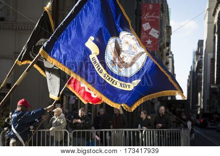 NEW YORK - 11 NOV 2016: Flag of US Navy, USN carried by personel marching in Americas Parade up 5th Avenue on Veterans Day in Manhattan.