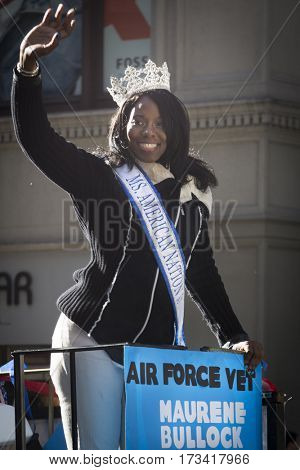 NEW YORK - 11 NOV 2016: US Air Force USAF vet and Ms. American Nation 2017 pageant queen Maurene Bullock waves from a parade float in Americas Parade up 5th Avenue on Veterans Day in Manhattan.