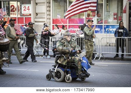 NEW YORK - 11 NOV 2016: A vet in a wheelchair takes part in the annual Americas Parade produced by the United War Veterans Council UWVC on 5th Avenue on Veterans Day in Manhattan.