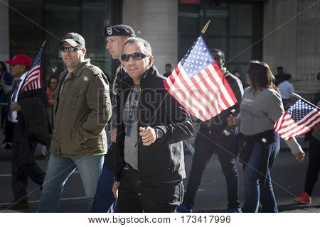 NEW YORK - 11 NOV 2016: Vets marching with the American Flag in the annual Americas Parade produced by the United War Veterans Council UWVC on 5th Avenue on Veterans Day in Manhattan.