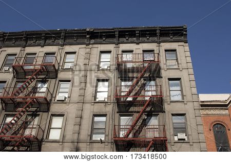 new york city architecture with fire escape stairs