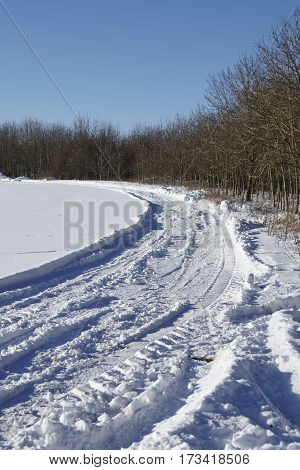 Skid Marks Into A Snowscape