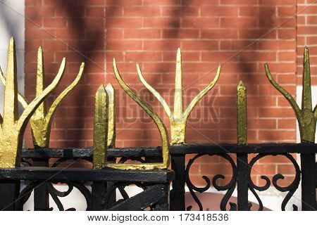 ornate wrought iron gates outside a house in new york city