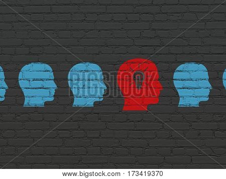 Business concept: row of Painted blue head icons around red head with light bulb icon on Black Brick wall background