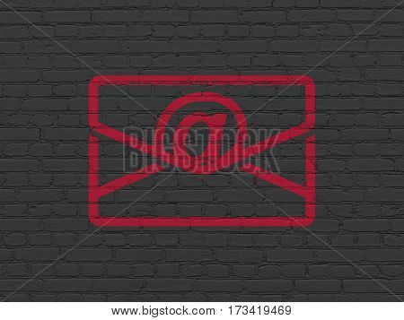 Business concept: Painted red Email icon on Black Brick wall background