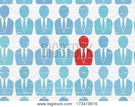 Finance concept: rows of Painted blue business man icons around red business man icon on White Brick wall background