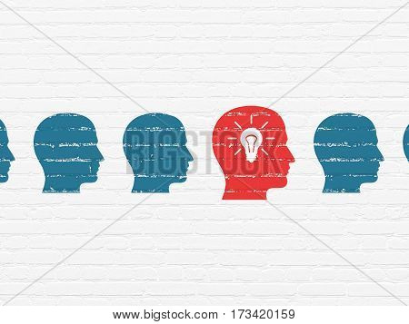Finance concept: row of Painted blue head icons around red head with light bulb icon on White Brick wall background
