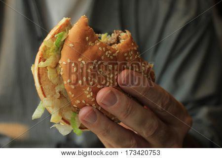 a man enjoying his fresh made hamburger