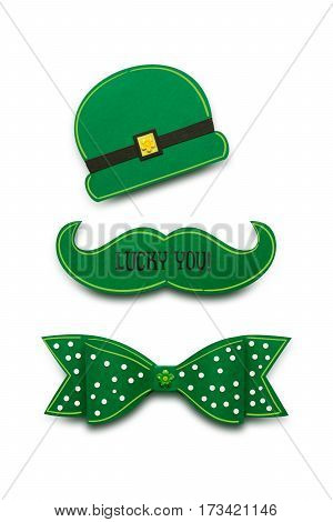 Creative St. Patricks Day concept photo of a moustache bow and hat made of paper on white background.