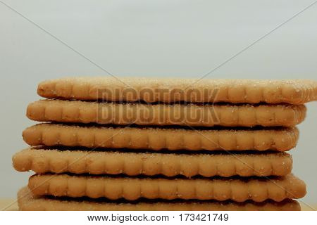 Stacked plain bisuits on a wooden cutting board