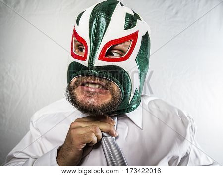 Executive, Angry businessman with iron mask on his face, is dressed in suit and tie