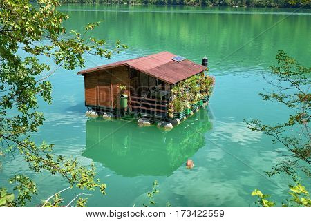 wooden house on river, Serbia