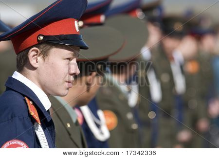 teens in uniform on Victory Day in Russia, selective focus on his face