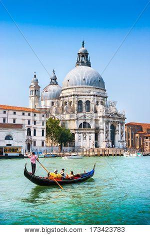 Traditional Gondola On Canal Grande With Basilica Di Santa Maria Della Salute In The Background, Ven