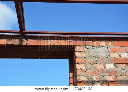 Close up on lintel. Window metal lintel on brick unfinished house construction.