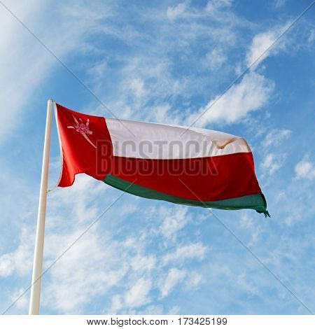 In Oman Waving Flag And The Cloudy Sky