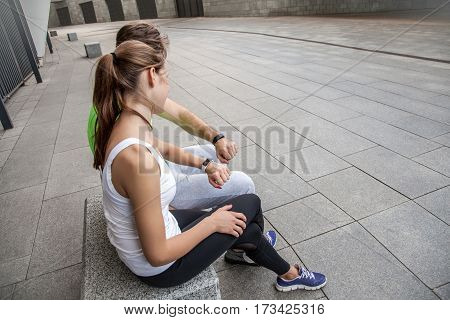 Couple using smart sport watch at workout.