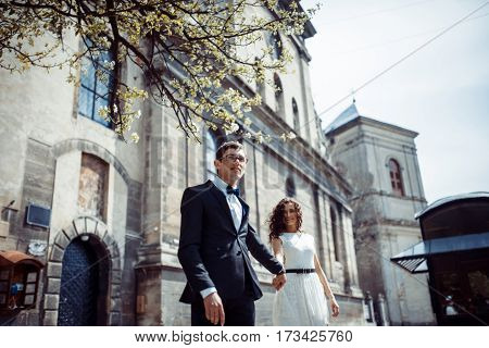 happy and loving couple walking and make photo in the old city.