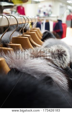 Hangers with coats and jackets in a clothing store
