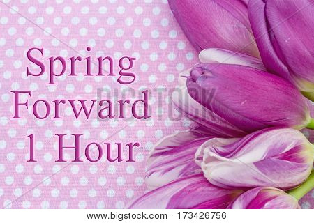 Spring Forward message A bouquet of purple tulips on pink polka dots with text Spring Forward 1 hour