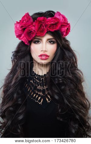 Fashion Model Woman with Long Healthy Hair Wearing Summer Wreath of Rose Flowers
