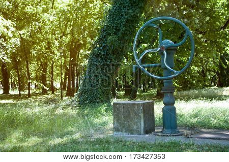 Old style water well and pump for water