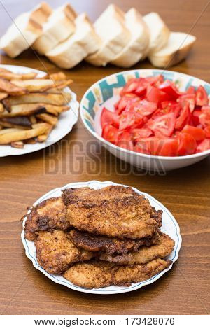 Breaded Steaks Served With Fried Potatoes