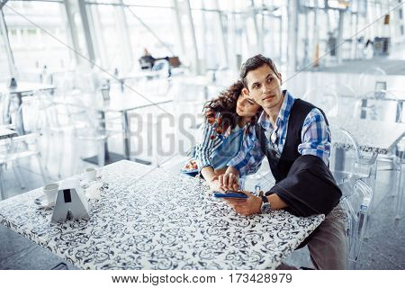 beautiful girl with a guy at the airport in the expected aircraft.