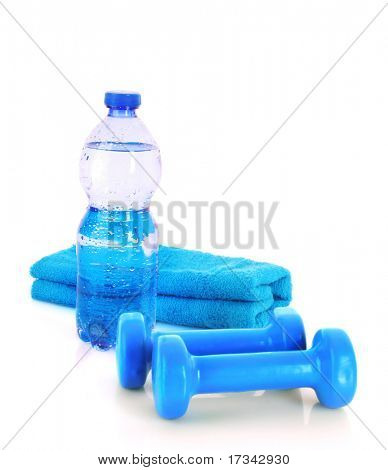 Blue bottle of water, sports towel and exercise equipment isolated against a white background