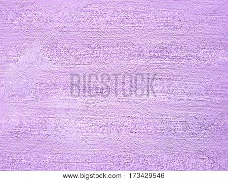 Canvas textured purple background. old concrete closeup
