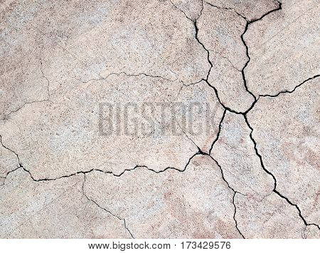 Gray Concrete Wall With Cracks Texture As A Background For Design