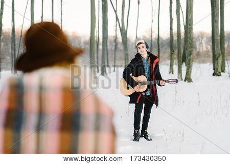 stylish boy with a camera portrait winter background