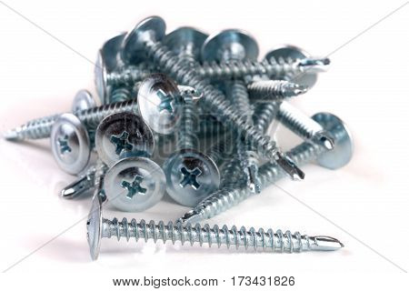 pile of metal screws isolated on white background.