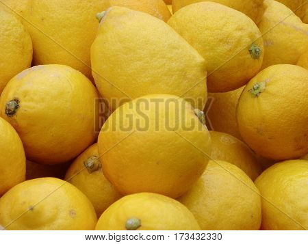 lemons on the market for sale as a background. Selective focus.