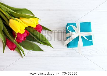 Flowers and gift. Top view. Concept of holiday birthday Easter March 8.