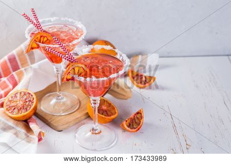 Cocktails with blood orange, rustic wood background, copy space