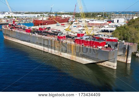Two ocean going sulfur tanker barges docked for repairs and to ship out