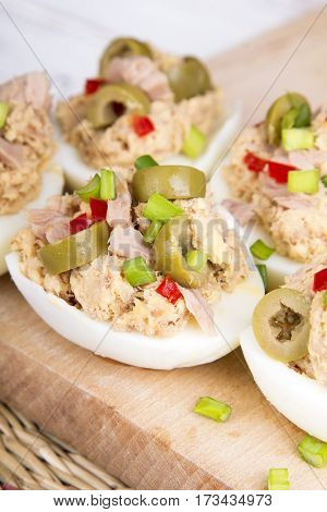 stuffed eggs with tuna olives and paprica