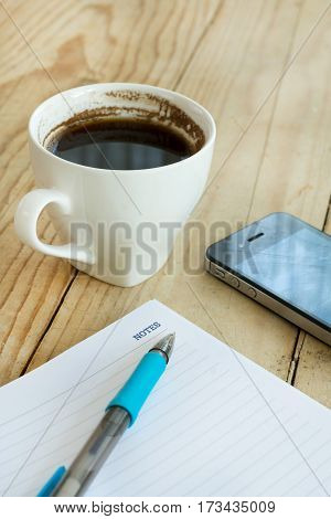 Word Notes On The Memos With Pen And Coffee On Wooden Background