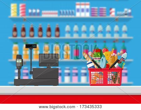 Supermarket interior. Cashier counter workplace. Shopping basket with food and drinks. Shelves with products. Cash register, pos terminal and keypad. Vector illustration in flat style