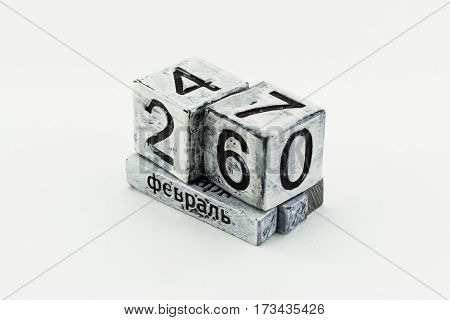 Desktop perpetual calendar in cyrillic isolated on white background