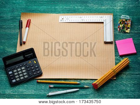 blank page with work tools on wooden background. Top view.